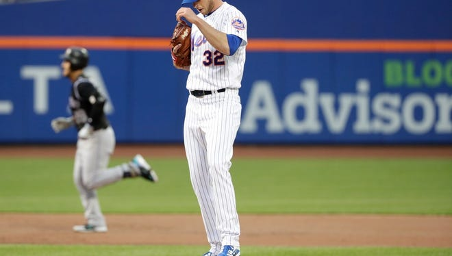 New York Mets' Steven Matz (32) reacts as Colorado Rockies' Nolan Arenado runs the bases after hitting a home run during the first inning of a baseball game Saturday, May 5, 2018, in New York.