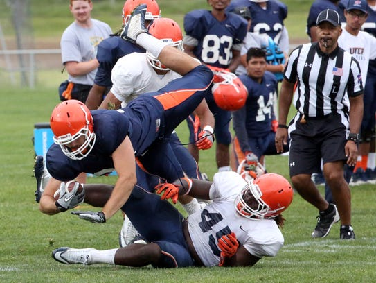 UTEP tight end Sterling Napier, 81, is brought down