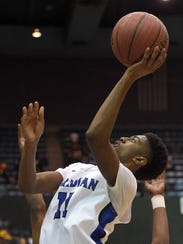 Meridian's Miles Miller (11) shoots from the baseline