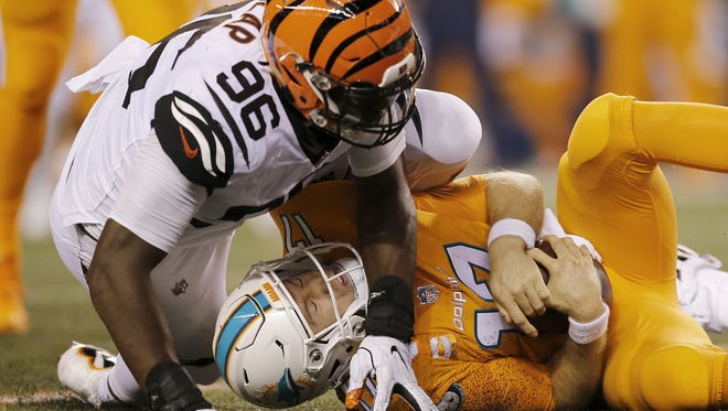 Miami Dolphins quarterback Ryan Tannehill (17) is sacked by Cincinnati Bengals defensive end Carlos Dunlap (96) in the third quarter of the NFL Week 4 game between the Cincinnati Bengals and the Miami Dolphins at Paul Brown Stadium on Thursday, Sept. 29, 2016. The Bengals improved to 2-2 with a 22-7 win over the Dolphins.