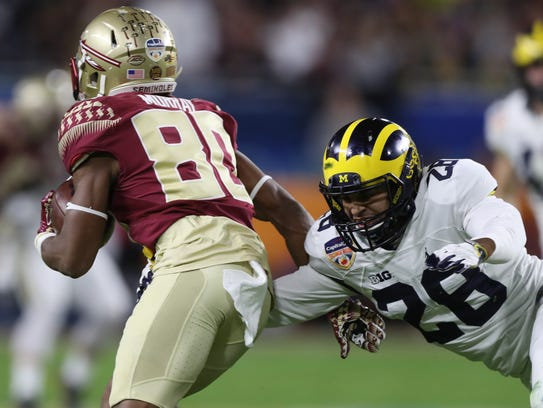 Michigan cornerback Brandon Watson tackles Florida