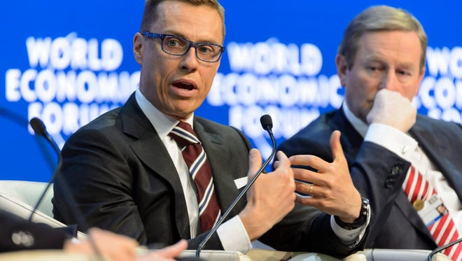 Finnish Prime Minister Alexander Stubb, left, attends a panel session of the 45th Annual Meeting of the World Economic Forum in Davos, Switzerland, on Jan. 22, 2015.