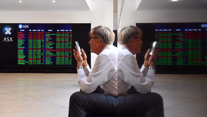 Market gains are displayed on the Australian Stock Exchange (ASX) trading board in Sydney, New South Wales, Australia, Jan. 9, 2017.
