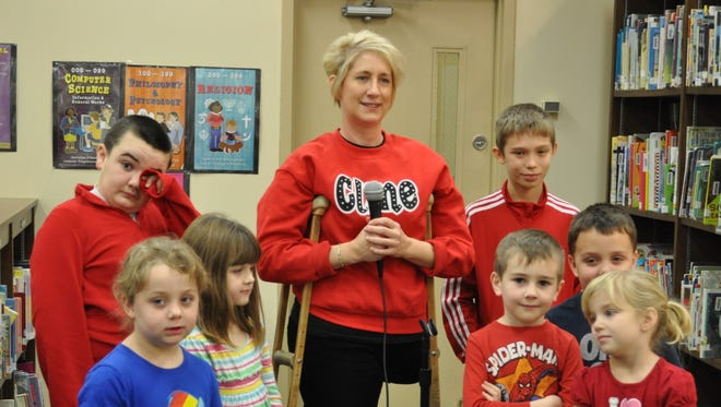 Amy Beal, center, is a school counselor in Kentucky battling cancer for the third time.