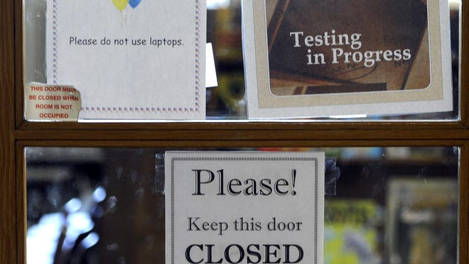 A sign on the door indicates ISTEP testing is going on in a classroom at Emmons Elementary School in Mishawaka, Ind.