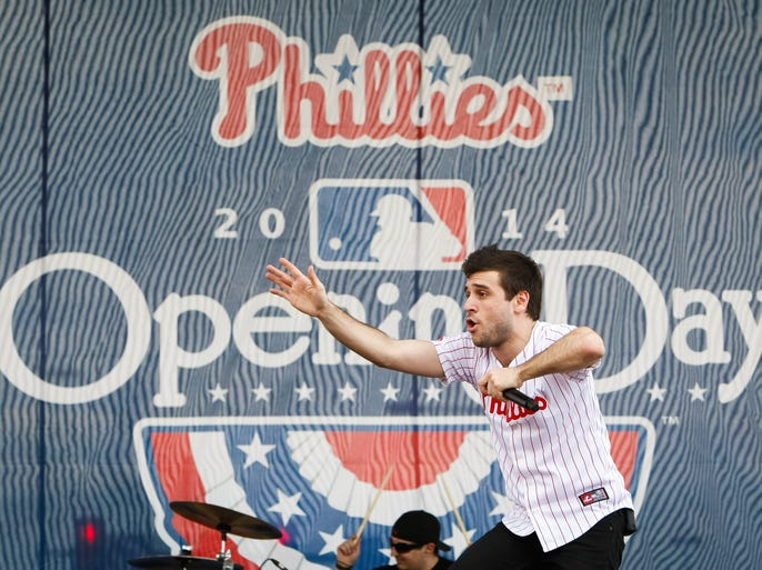Fans jam to some live music outside Citizens Bank Park before the home opener on Tuesday.