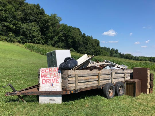 The scrap metal load sitting outside Bible Church on 5294 North Brownsville Road.