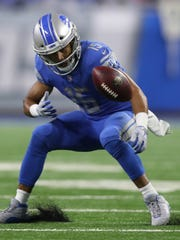Lions wide receiver Golden Tate fumbled the ball in
