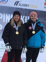 Staci Mannella, right, a visually impaired skier from Randolph, and her guide Sadie DeBaun won gold medals in the slalom and giant slalom at World Cup races in Tarvisio, Italy.