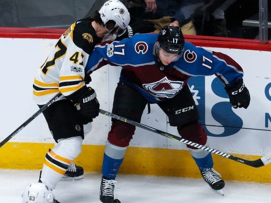 Colorado Avalanche center Tyson Jost, right, vies for control of the puck with Boston Bruins defenseman Torey Krug during the third period of an NHL hockey game Wednesday, Oct. 11, 2017, in Denver. Colorado won 6-3. (AP Photo/David Zalubowski)