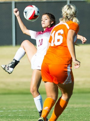 New Mexico State University's Aileen Galicia gets a leg on the ball on Saturday while Texas-Rio Grande Valley's Tuva Rolstad Nilsen looms in the foreground.