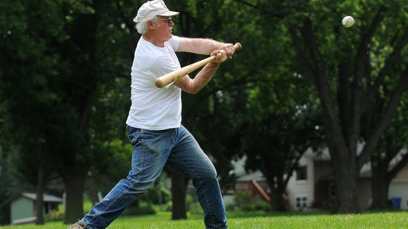 Steve Johnson, of Sioux Falls, bats during the annual Phil Roof baseball game on Saturday, July 4, 2015, at Riverdale Park in Sioux Falls. The group gets together every year for the 4th of July to play baseball.
