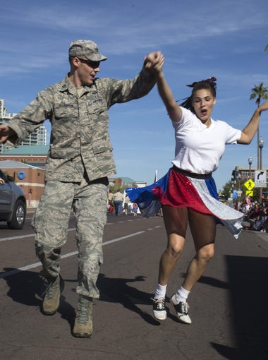 Ryan Gustafson (left) and Natalia Skinner of the Arizona Swing Kids dance during Tempe's Veterans Day Parade on Nov. 10, 2017.