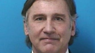 Police booking photo of Superintendent Mike Looney.