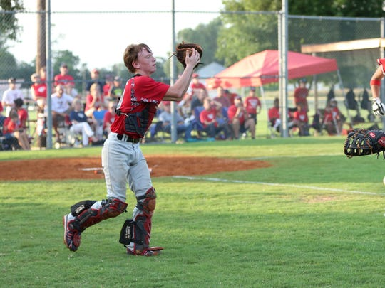 The catcher for Madison Central, Tristan Cook, easily
