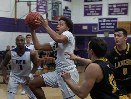 Rumson-Fair Haven's Devin Cooper (2) drives into the paint area against St. John Vianney on Jan. 16, 2018. Photos by Peter Ackerman