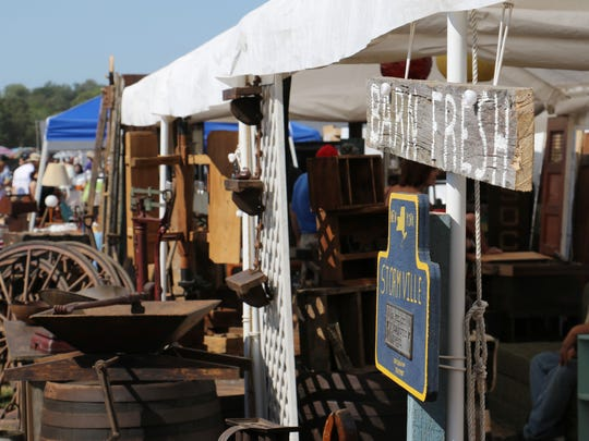 A line of vendors selling antiques at the  Stormville Airport Antique Show and Flea Market in .