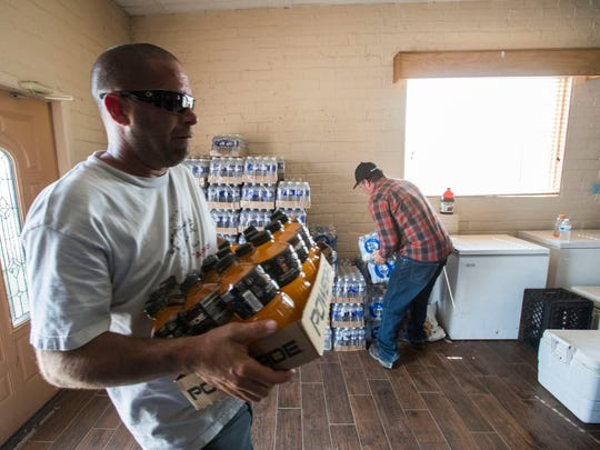 Water and other drinks are donated at the Anza Community Center after lack of electricity has taken a toll on the community.