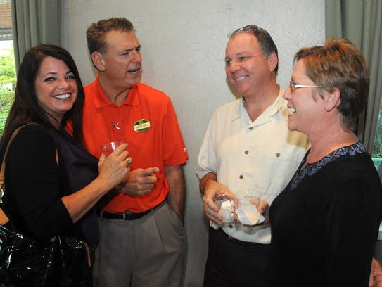 Sherrie and Bob Pfeffer, left, talk with Stanley and