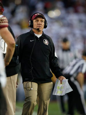 Florida State head coach Jimbo Fisher looks up at the scoreboard late in their loss to Oregon in the Rose Bowl NCAA college football playoff semifinal, Thursday, Jan. 1, 2015 in Pasadena, Calif. (AP Photo/Doug Benc)
