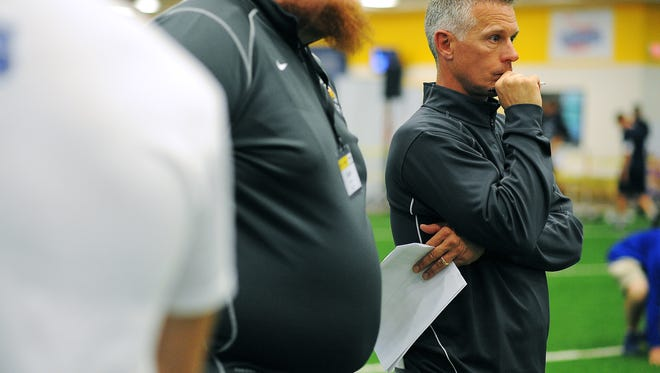 Augustana head football coach Jerry Olszewski looks on during the Sanford POWER Riggs Premier Football Academy 2015 Recruiting Combine on Saturday, May 9, 2015, at the Sanford Fieldhouse in Sioux Falls. College football coaches from schools in South Dakota, Minnesota, Iowa, North Dakota and Nebraska attended the event.