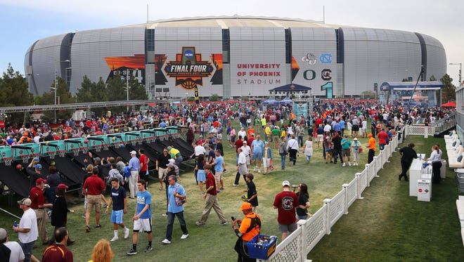 College basketball fans hang out during the NCAA Tip-Off Tailgate outside of University of Phoenix Stadium in Glendale before the NCAA Final Four semifinal game between South Carolina and Gonzaga on April 1, 2017. Oregon plays North Carolina in the other NCAA Final Four semifinal game.