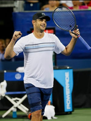 Andy Roddick celebrates after winning his doubles match with Mardy Fish (not pictured) against Yen-Hsun Lu and Jonathan Marray (both not pictured) during the BB&T Open at Atlantic Station on July 29, 2015.