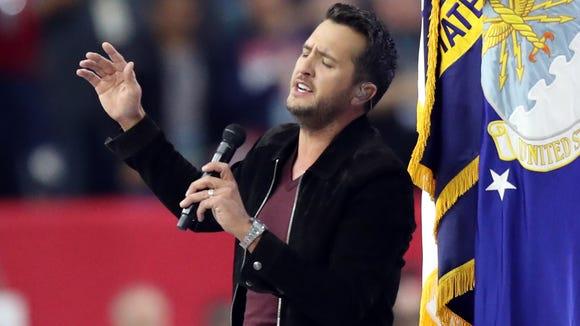 Feb 5, 2017; Houston, TX, USA; Luke Bryan sings the National Anthem prior to Super Bowl LI between the Atlanta Falcons and the New England Patriots at NRG Stadium. Mandatory Credit: Kevin Jairaj-USA TODAY Sports ORG XMIT: USATSI-348602 ORIG FILE ID: 20170205_ajw_aj6_081.jpg