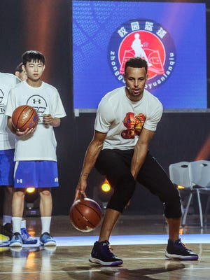 Stephen Curry participates in the Jr. NBA basketball clinic of the Jr. NBA All-Star Week in Beijing, China on July 22, 2017.