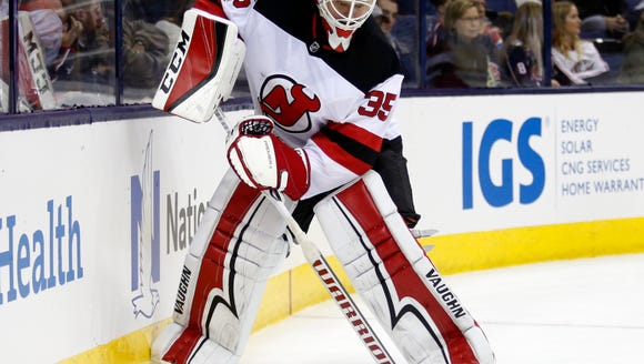 New Jersey Devils goalie Cory Schneider clears the