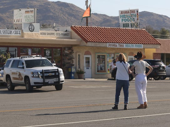 Two women jaywalk across 29 Palms Hwy. as a Sherif