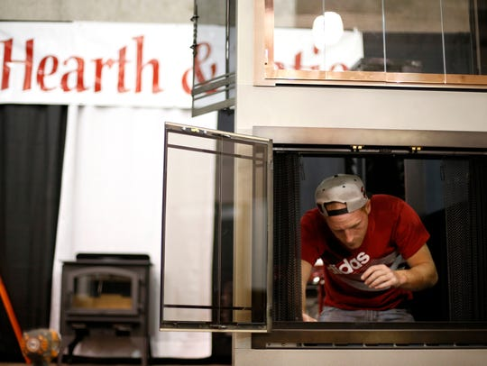Dalan Lafave of Hearth & Patio sets up his company's display at the Civic Center during a previous Home Show. This year's event is Feb. 8-10.
