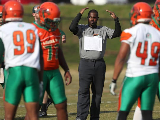 FAMU football coach Willie Simmons instructs his team
