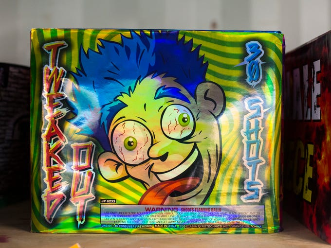 """A firework called """"tweaked out"""" sits on the shelf at"""