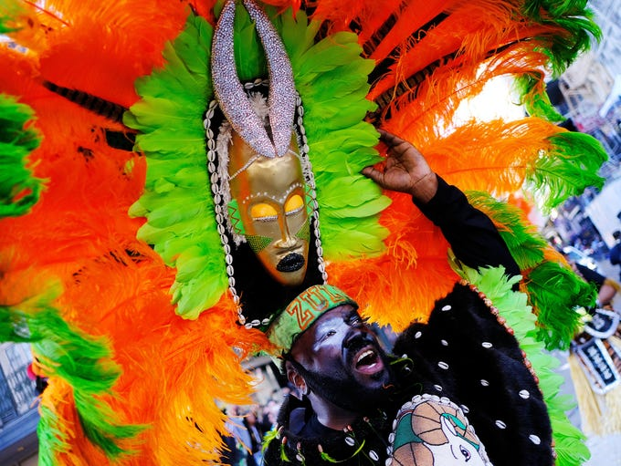 A foot marcher with the Krewe of Zulu makes his way
