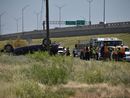 Police investigate a vehicle rollover on June 11, 2018