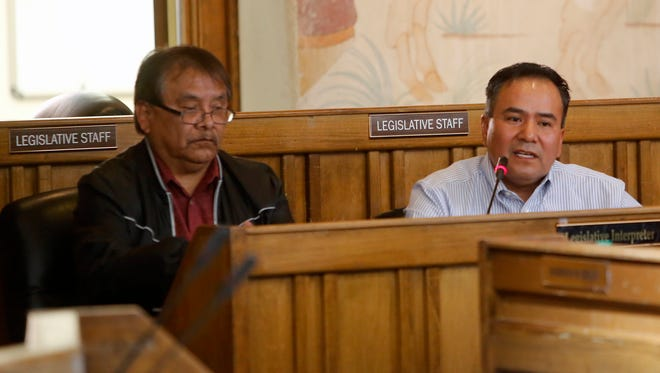 Arbin Mitchell, left, chief of staff for the Navajo Nation Office of the President and Vice President, and Lorenzo J. Begay listen to the deliberations of the Resources and Development Committee on Friday in Window Rock, Ariz. The committee confirmed Begay's service on the Navajo Agricultural Products Industry board of directors.