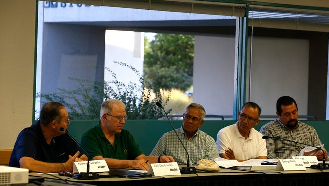 Members of the Gold King Mine Citizens' Advisory Committee gather for a meeting on Monday at San Juan College in Farmington.