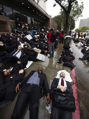 Lawyers, law students and legal staff in Los Angeles protest on Dec. 16.
