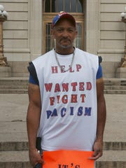 Roy Townsend prepares for the protest at Hamilton County