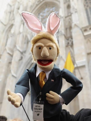 A Trump puppet with bunny ears at the New York City Easter Parade on March 27, 2016.