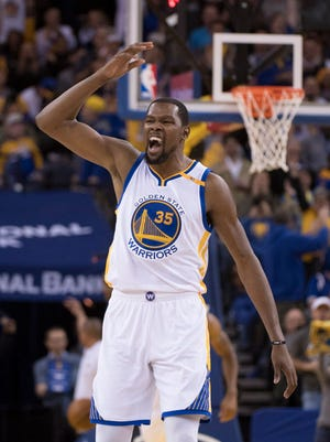 Warriors forward Kevin Durant (35) celebrates during the fourth quarter against the Hawks.
