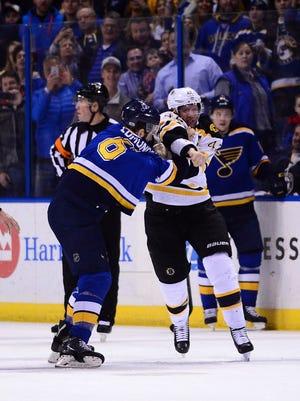 Bruins forward David Backes (42) fights Blues defenseman Joel Edmundson (6) during the second period.