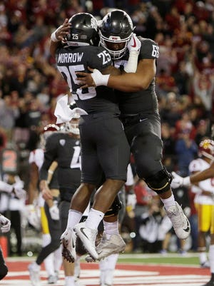 Washington State running back Jamal Morrow (25) celebrates his touchdown with offensive lineman Frederick Mauigoa (69) during the first half against USC.