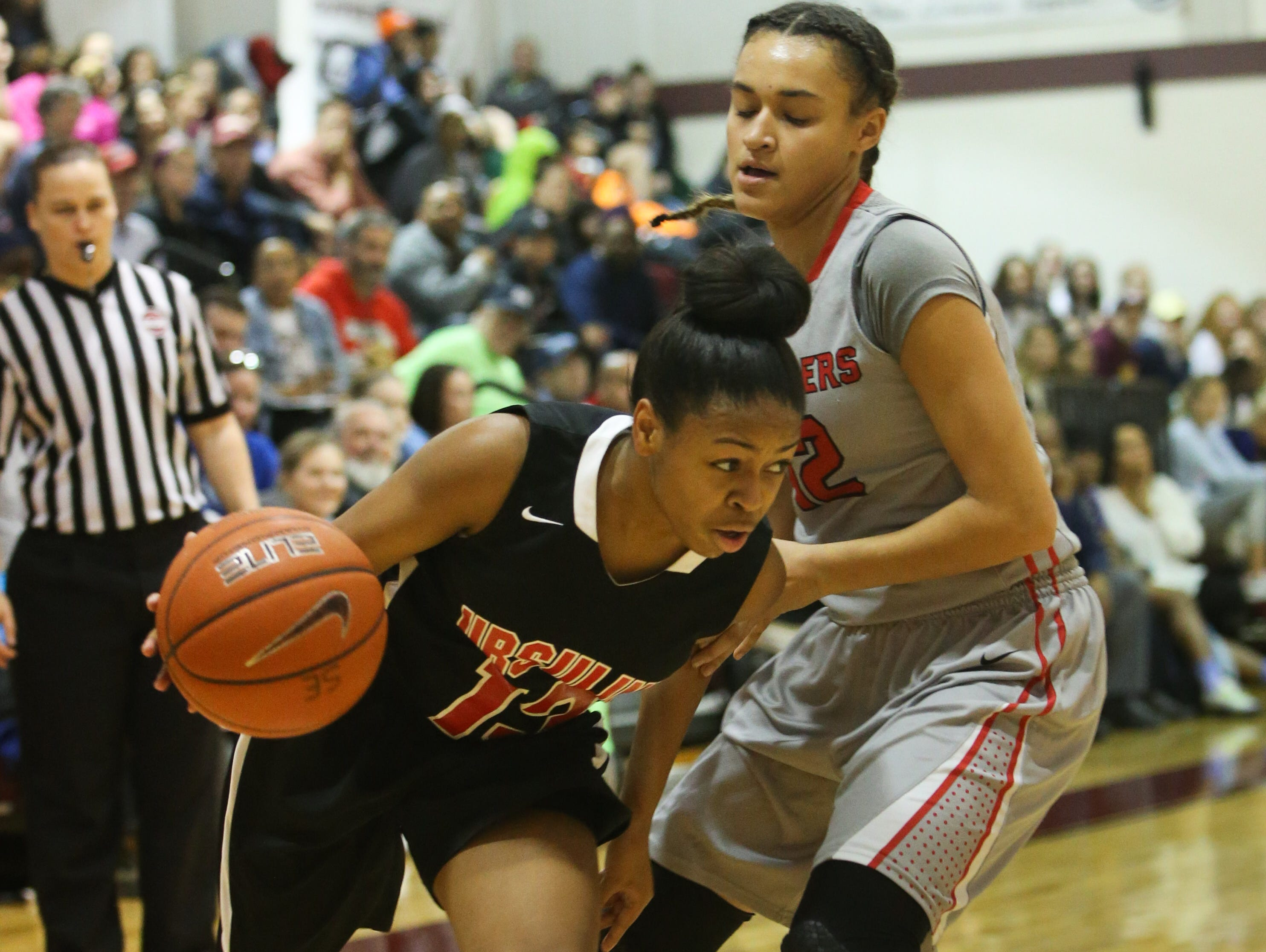 Ursuline guard Sabriya Harris drives past Long Island Lutheran guard Celeste Taylor in the first quarter. Ursuline falls to Long Island Lutheran 52-55 in the semifinals of the Saint Francis Healthcare Cup of the Diamond State Classic at St. Elizabeth High School Tuesday.