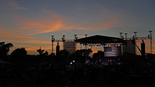 The sun sets behind the stage during the Fourth on Broadway festival, Thursday, July 4, 2019, at Mackenzie Park in Lubbock, Texas.