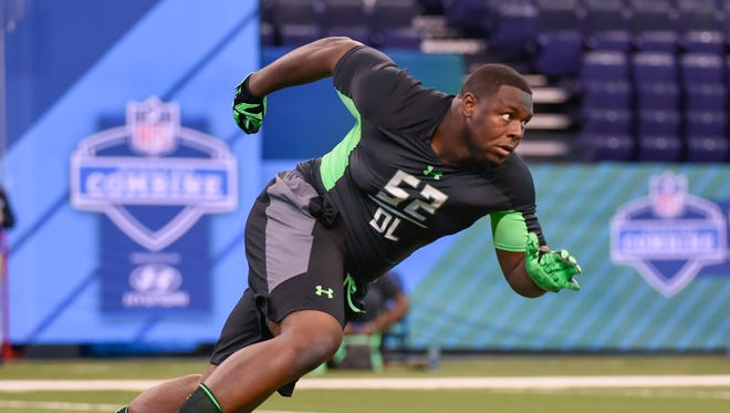 Texas defensive lineman Hassan Ridgeway runs a drill at the NFL football scouting combine, Sunday, Feb. 28, 2016, in Indianapolis.
