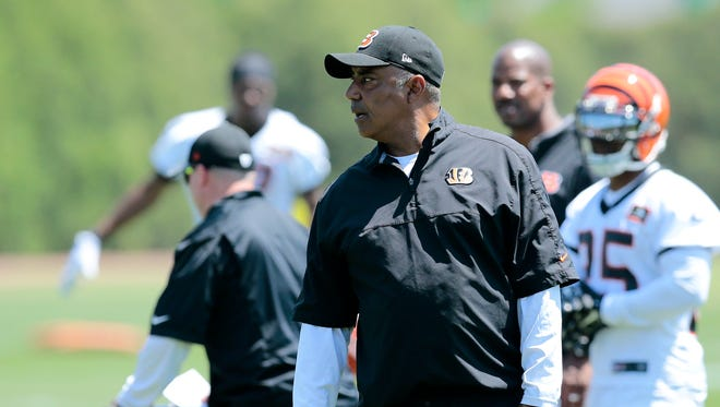 Bengals head coach Marvin Lewis gives feedback during OTAs at the team's practice field next to Paul Brown Stadium on Tuesday.
