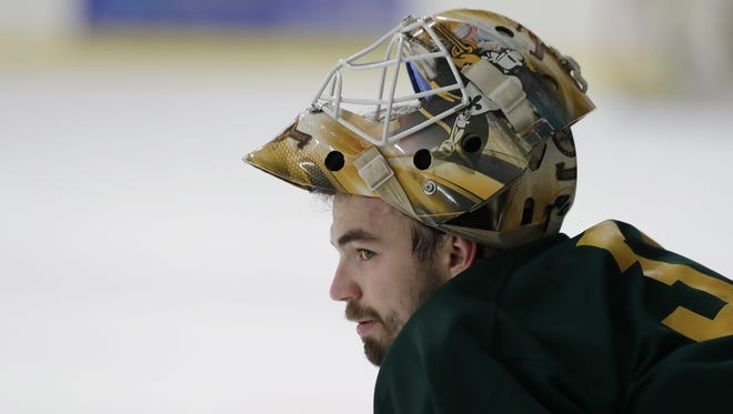 St. Norbert senior goalie Tony Kujava watches a drill during practice at the Cornerstone Community Center on Tuesday in Ashwaubenon. Kujava has played a majority of his hockey career at the facility, which opened in 2000.