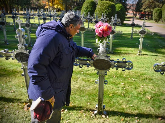 Patrick Norton visits the grave of Sister M. Annella Zervas at St. Benedict's Monastery Tuesday, Oct. 24, in St. Joseph. Norton says Zervas appeared to him while he was working on campus. He is working to have her recognized as a saint.